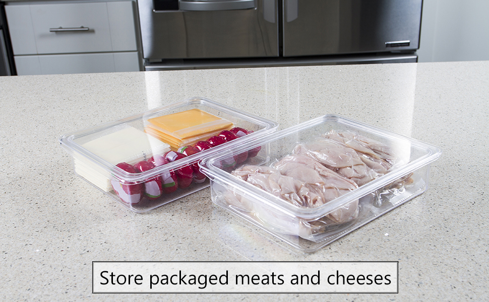 Deli bins on granite counter with meats and cheeses