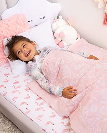 girl laying in toddler bed with blanket