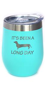 Text says It's been a long day, with design of a dachshund engraved on an insulated tumbler