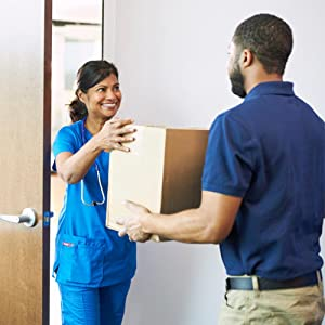 Delivery man giving a box of McKesson products to a nurse