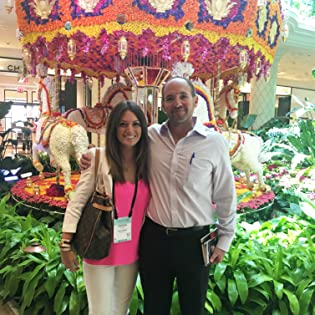 Amanda Rose Collection founder in front of carousel covered in roses