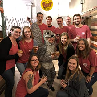 Employees at the BEER NUTS factory. One employee is dressed in a squirrel costume.