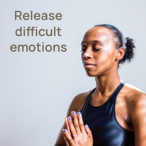 The words: release difficult emotions and a picture of a woman meditating and looking happy