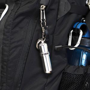 fuel canister attached to backpack, swivel clip