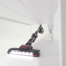 Roomie Tec Cordless Stick Vacuum Cleaner with low reach under furniture and LED headlights