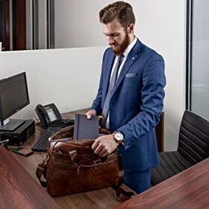 Confident business man ready to tackle any meeting with notebook, phone or tablet feeling great