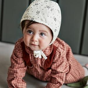 barn med mössa från elodie details