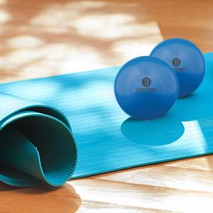 home, yoga mat and ball