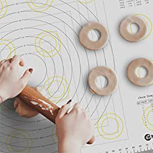Rolling pin and cookies on xxl pastry mat
