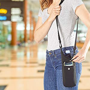 woman in airport with black neoprene bottle holder