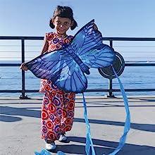 Girl holding X Kite