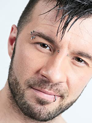 GUY WITH MULTIPLE PIERCINGS