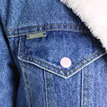 denim jacket with pink buttons