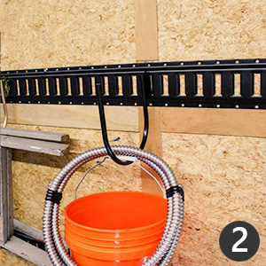 E-Track hooks hanging from E-Track with pail