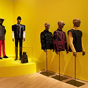 Pierre cardin yellow background with mannequins