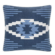 a blue and white native american inspired pillow