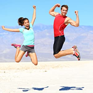 Active couple jumping into the air