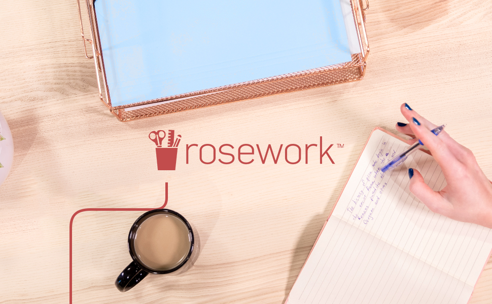 women writing in her notebook that was taken from the rose gold letter tray while drinking coffee