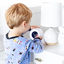 Boy playing with MELLA clock