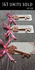 White tags with rose gold foiling and rose gold key bottle opener wedding favor, pink ribbon