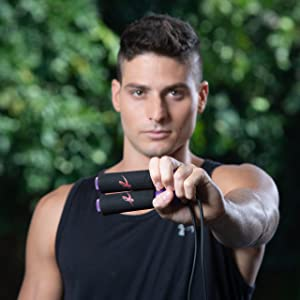 A person holding the Fitness Factor Jump Rope
