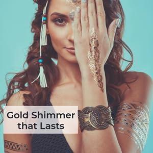 Gold shimmer body art tattoos