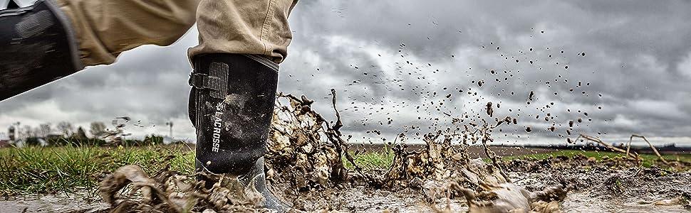 man walking on a mud