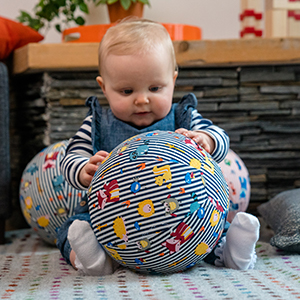 Baby plays with BubaBloon Cover - Helping them sit up
