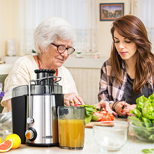 a grandma and daughter cooking along with centrifugal juicer machine