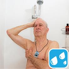 man in shower wearing pendant