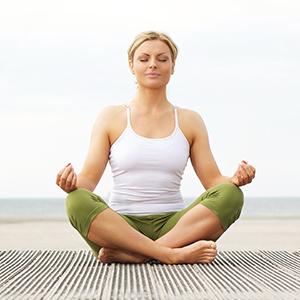 Beautiful woman doing yoga outdoors