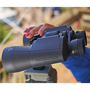 Woman holding the Bushnell Powerview 2 Binoculars while its on a stand