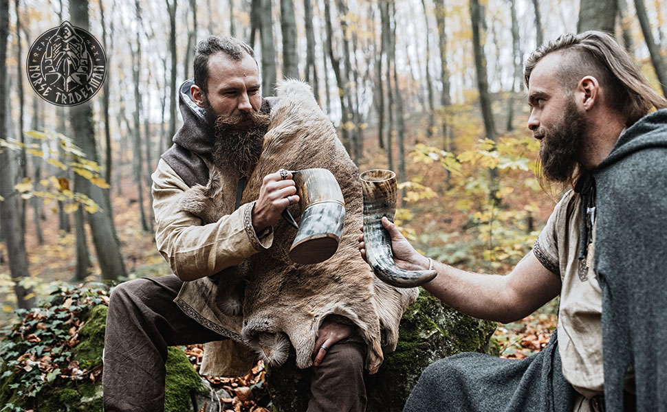 Vikings enjoying an ale from their Norse drinking horns