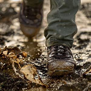 man walking on the mud