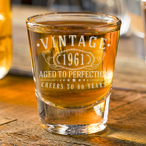 two Vintage etched custom shot glasses