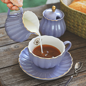 Cream Pitcher and Sugar Bowl