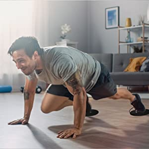 Man doing mountain climbers at home using Limm Core Sliders