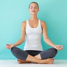 Women sitting on floor and doing yoga