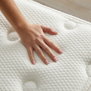 Hand touching mattress