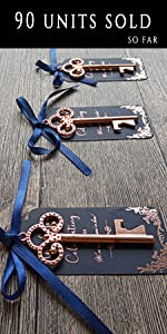 navy blue tags with rose gold foiling and rose gold key bottle opener wedding favors