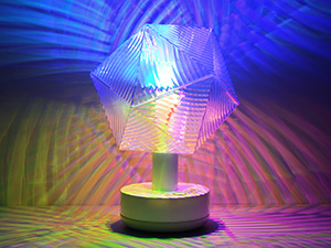 Party Lamp Kit shining light projections in colorful patterns on the wall and room