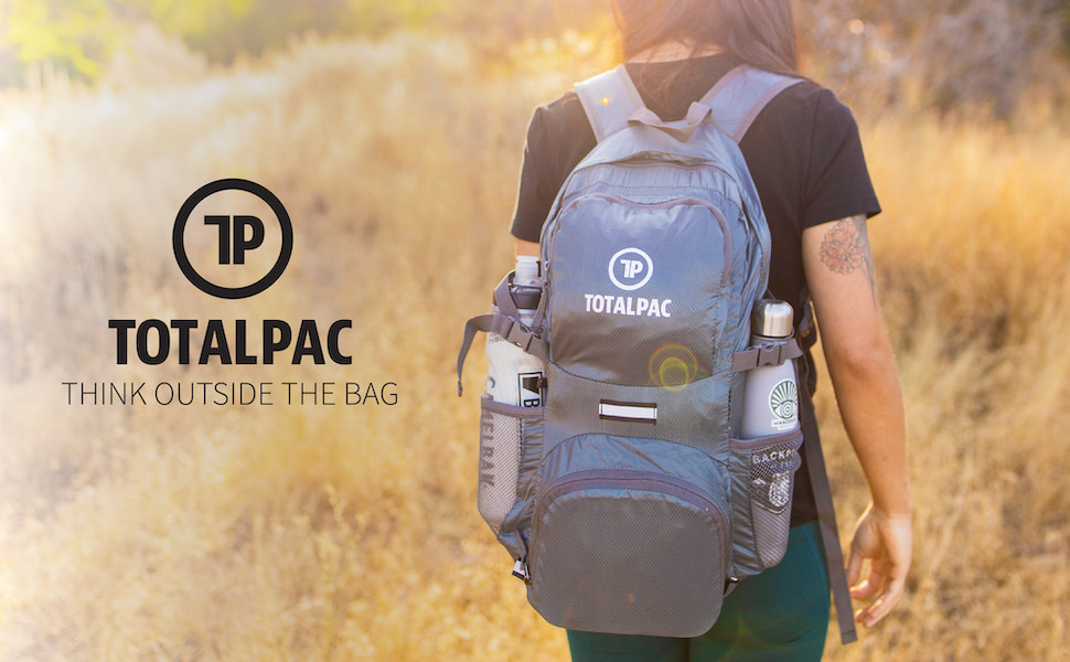 Fully loaded Totalpac backpack being worn by a hiking woman.