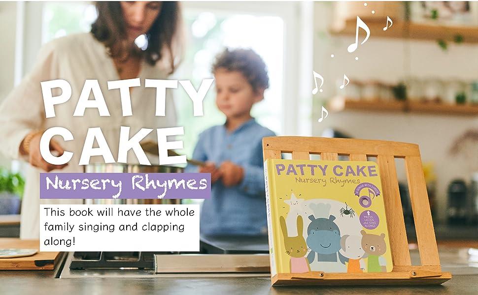 TODDLER BOY AND MOM ENJOYING PATTY CAKE NURSERY RHYME SOUND BOOK