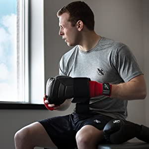 Image of athlete putting on boxing gloves over the Gel Glove quick wraps
