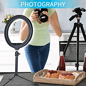 A girl took photos, and the ring light on desk.