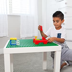 Peel 'n Stick Baseplates applied to a building brick table with young boy playing with blocks
