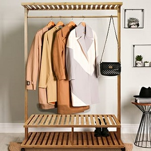 Showing the Bamboo rack with winter coats, hand bag and boots in a minimalist environment