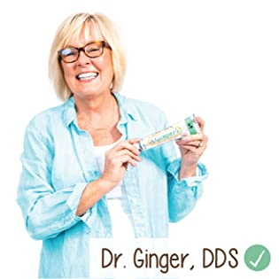 Dr. Ginger, DDS holding up a tube of her toothpaste.