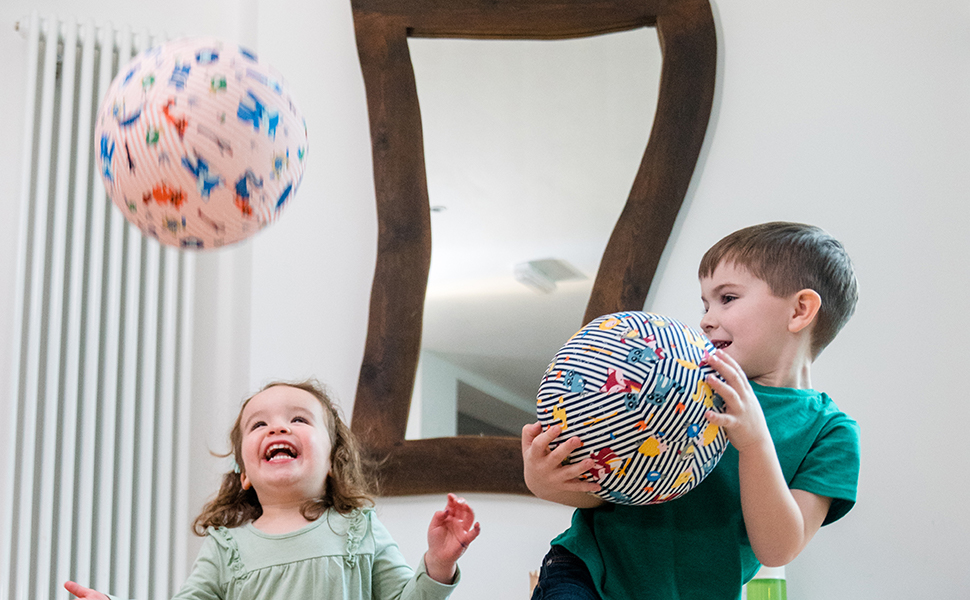 2 Children play with BubaBloon Balloon Cover Sensory Toy