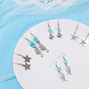 A lovely tibetan silver and turquoise bead  starfish themed  pendant necklace.